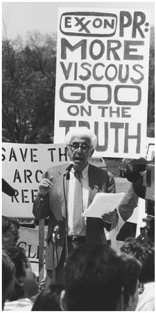 Barry Commoner speakingto a group of protesters gathered outside a New Jersey hotel where Exxon stockholders met in 1989. (Corbis-Bettmann. Reproduced by permission.)